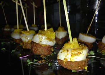 The Rusty Pelican - Pistachio Crusted Scallops on a Boñiato & Pineapple Garnish Pistachio Crusted Scallops on a Boñiato & Pineapple Garnish The Rusty Pelican, another Miami staple, is known for its innovative dishes and amazing views; these scallops were A-MAZING!