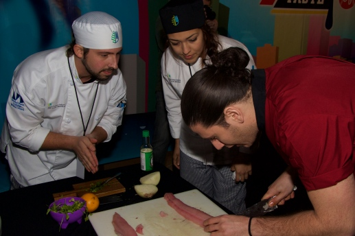 MCI Students learning the tricks of the trade from Chef James @ Taste of Miami 2015