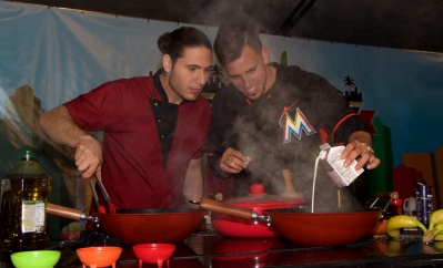 Miami Marlins' pitcher José Fernandez learning a new trade from celebrity Chef James Tahhan @ Taste of Miami 2015